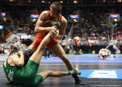 Campbell's Quintin Perez grabs the leg of Utah Valley's Demetrius Romero during their wrestle back bout at the NCAA Wrestling Championship in Cleveland.