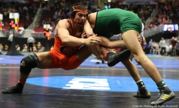 Utah Valley's Demetrius Romero takes down Campbell's Quintin Perez during their bout at the NCAA Wreslting Championship in Cleveland. Romero won the bout and advanced to wrestle Minnesota's Nicholas Wanzek.