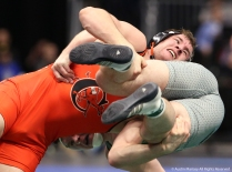 Campbell's Jere Heino takes down George Mason's Matt Voss during their wrestleback bout in the NCAA Wrestling Championship in Cleveland. Hieno won and went on to defeat Arizona State's Tanner Hall.