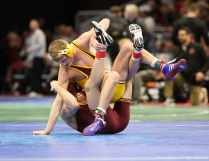 Central Michigan's Mason Smith tries to stay off his back while wrestling Minesota's Thomas Thorn at the NCAA Wrestling Championship in Cleveland.