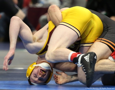 Central Michigan's Justin Oliver struggles to not be pinned against Princeton's Matthew Kolodzik during the NCAA Wrestling Championship in Cleveland.