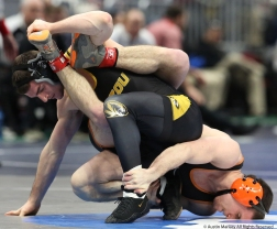 University of Missouri's Connor Flynn holds Princeton's Jonathan Schleifer on his face during their bout in the NCAA Wreslting Championship in Cleveland.