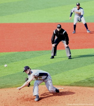 Canisious College's junior pitcher Nolan Hunt throws a pitch during the game at Kent State on Wednesday, April 11.