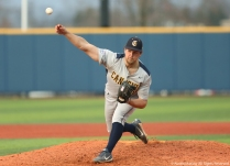 Canisius College's senior pitcher Tyler Smith throws a pitch during the game at Kent State on Wednesday, April 11, 2018.