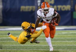 Bowling Green State University's Josh Cleveland breaks a tackle by Kent State's Miles Daniel during the game at Dix Stadium.