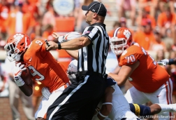 Kent State and Clemson players run over a referee during the season opener at Clemson on Sept. 2, 2017.