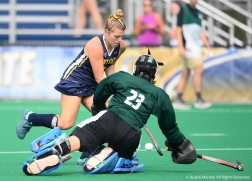Kent State senior forward Coutney Weise drives passed Ohio University goalie Nele Graner during an exhibition game at Kent State University on Sunday, Aug. 19, 2018.
