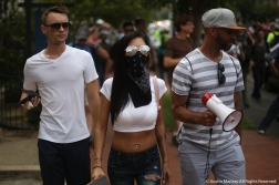 Three counter protesters walk along side the withe supremacists taking part in the Unite the Right Rally 2 in Washington D.C. on Sunday, Aug. 12, 2018.