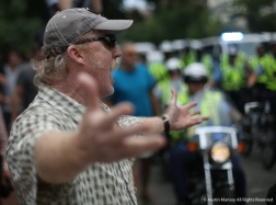 Joseph Longfellow of Roanoke, Virginia throws his hands in the air and yells to the white supremacists taking part in the Unite the Right Rally 2 in Washington D.C. on Sunday, Aug. 12, 2018.