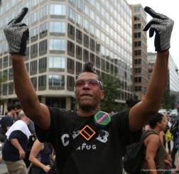 David Confer flips off the white supremacists participating in the Unite the Right Rally 2 in Washington D.C. on Sunday, Aug. 12, 2018. Confer said his mother was kicked out of school in the 60's for taking inspiration from the Friendship 9 and sitting at segregated lunch counters.