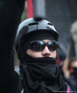 An Antifa demonstrator raises his hist in the air after the Unite the Right Rally 2 in Washington D.C.