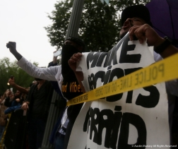 A protester yells at a small rogue group of white supremacists long after the Unite the Right Rally 2. The rogue group was walking passed the White House and the counter demonstrators noticed them and chased them down causing Secret Service to take them into protective custody and drive them away from the scene in government vehicles.