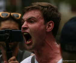 Patrick Junghenn, 22, screams at white nationalist demonstrators through a line of Capitol Police duirng the Unite the Right 2 march in Washington D.C. on Sunday, Aug. 12, 2018.