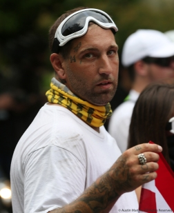 A white supremacist looks into the camera while participating in the Unite the Right Rally 2 in Washington D.C.
