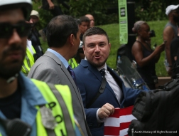 Jason Kessler, the father of the Unite the Right Rally, marches behind hundreds of police officers to Lafayette Square to partake in the second annual Unite the Right Rally on the anniversary of the death of Heather Heyer.