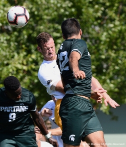 Michigan State University's senior defender John Freitag and Canisius College's freshman defender Alessio Atzori both attempt to head the ball during a match at Michigan State University on Friday, August 31.