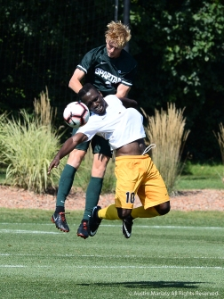 Canisius College's senior midfielder Melvin Blair and Michigan State's redshirt sophomore Patrick Nielson both try to head the ball during the match at Michigan State. The Spartans won 3-2.