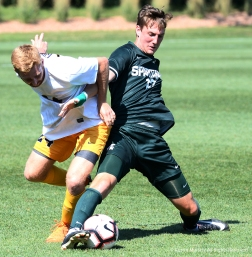 Canisius College's senior forward Hunter Walsh and Michigan State's senior midfielder Robbie Cort battle for the ball during a match at Michigan State University.