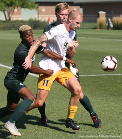Michigan State University's freshman defender Will Perkins battles with Canisius College's sophomore forward Filippo Tamburini for control of the ball during a match at Michigan State on friday, Aug. 31. Michigan State won the match 3-2.