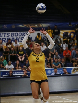 Kent State senior defensive specialist Sam Jones sets the ball during a match against Youngstown State University.