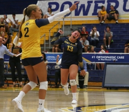 Kent State's freshman defensive specialist Erin Gardner celebrates after it became apparent that Kent would defeat Youngstown State University in 4 sets.