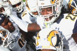 Kent State's senior linebacker Jim Jones gets the team hyped up for the start of the rivalry game against the University of Akron. The Flashes lost on a failed extra point attempt in overtime.
