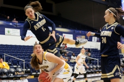 University of Akron's redshirt senior Megan Sefcik jumps and tumbles over Northern Kentucky University's sophomore forward Kailey Coffey during a play in the second women's game of the Kent State Classic hosted by Kent State University on Nov. 18, 2018.