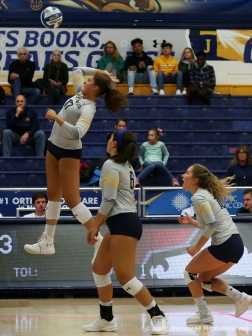 Kent State's freshman middle backer Danie Tyson attemots a kill during the match against Northern Illinois University.