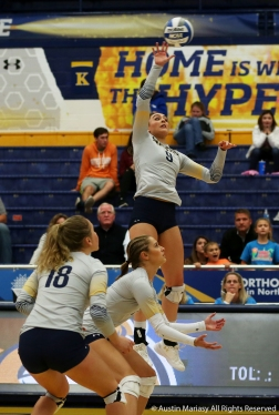 Kent State's senior outside hitter Lexi Mantas attempts a kill during the match against Northern Illinois University.