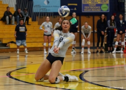 Kent State's senior outside hitter Lexi Mantas slides on her knees for a save during the matach against Norther Illinois University. The Flashes won 3 sets to 2.