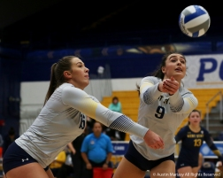 Kent State's senior outside hitter Lexi Mantas and junior outsider hitter Ashley Makruski both try to hit the ball against Northern Illinois.