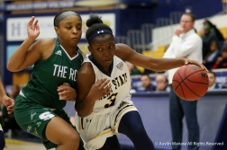 Kent State's freshman guard Asiah Dingle drives passed Slippery Rock's redshirt sophmomore guard Kasch Harris during an exhibition game at Kent State University on Nov. 4, 2018.