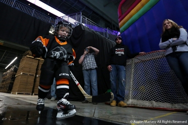 Colton Cerni, 4, follows the Youngstown Phantoms' goalie onto the ice for the team's introductions before the game against the Madison Capitals on Nov. 24, 2018.