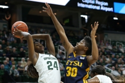 East Tennessee State's senior forward Sadasia Tipps attempts to block the shot by Michigan State's freshman guard Nia Clouden during the game at Michigan State University on Nov. 11, 2018.