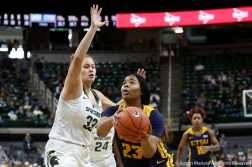 East Tennessee State's senior forward Britney Snowden drives passed Michigan State's senior center Jenna Allen during the game at Michigan State on Nov. 11, 2018