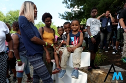 """Skye Marie, 1 (left); Chance, 4 (center); and Jeion, 4, all sit on the statue spelling """"I Promise"""" in front of LeBron James' new school in Akron, Ohio on Monday, July 30, 2018. James paid $2 million to help open a new public school in Akron for at risk youth. Any kid who graduates from his school will receive a scholarship to the University of Akron."""