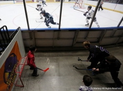 Children play hockey next to the glass during a game at the Covelli Center in Youngstown, Ohio.