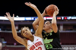 University of South Florida junior post Tamara Henshaw attempts to shoot through Ohio StateÕs freshman forward Aaliyah Patty during the season opener at Ohio State on Tuesday, Nov. 7, 2018