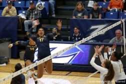 Kent State's freshman middle blocker Danie Tyson goes up for a kill durign the rivalry game at the Univeristy of Akron on Nov. 3, 2018.