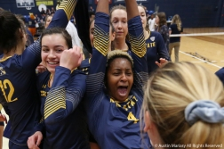 Kent State's junior middle mlocker Myla King celebrates after they defeated the Univeristy of Akron in 5 sets in the annual rivalyr challenge.