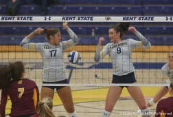 Kent State's freshman middle blocker Danie Tyson (left) and senior outside hitter Lexi Mantas watch as the ball falls between them during the match against Central Michigan University. The flashes won the match in 5 sets.