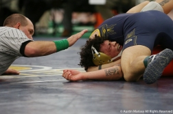 Cowley College's Jesse Nunez cries out in pain as he is pinned while having his elbow dislocated by Kent State's Dylan Barreiro during their bout at the Kent State Duals on Kent, Ohio on friday, Nov. 2, 2018.