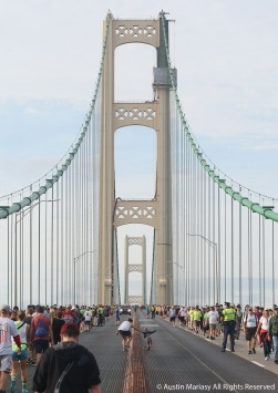 A mom grabs her small child as he tries to run across the barrier on the Mackinac Bridge in Michigan. The bridge is normally closed to pedestrians but every memorial day, the bridge authority opens the 5 mile long bridge to pedestrians to walk from Michigan's upper peninsula to the lower mitten.