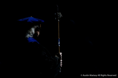 The mace bearer stands at attention during the procession of graduates at the Kent State University graduate student commencement on Friday, Dec. 14, 2018.