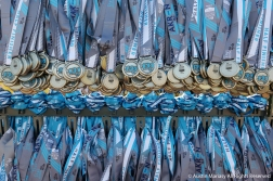 Medals wait at the finish line of the Akron Marathon for runners to finish the race and claim them.