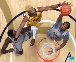 Kent State University's freshman forward BJ Duling attempts to recover a rebound during the game against Akron on Friday, March 2, 2018. Kent State lost the rivalry game and spilt the annual Battle of the Wagon Wheel, an annual, multi-sport contest between Kent State and the University of Akron. Going into the 2018-2019 basketball season, the Akron Zips lead the Golden Flashes 3-2.