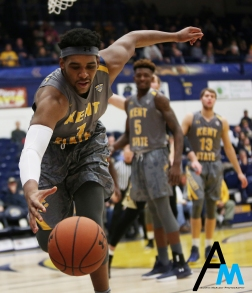Kent junior guard Adonis De La Rosa attempts to keep the ball inbounds against Western Michigan University on Tuesday, Jan. 16, 2018. Kent State won the game on a last second layup by then sophomore Mitch Peterson.