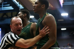 A referee pushes two Chicago State players away from a fight during the game at the University of Akron on Nov. 16, 2018.
