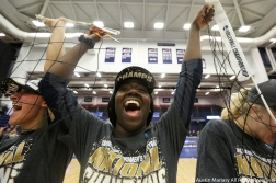 Emory University's freshman middle blocker Kaia Johnson celebrates after the team defeated Calvin College in the NCAA Division 3 Championship game in Pittsburgh, Pennsylvania on Nov. 17, 2018. Volleyball championships end with the winning team cutting up the net and keeping pieces of it as souvenirs.