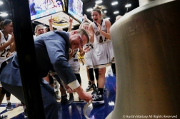 Kent State University's Head women's basketball coach Todd Starkey rings the victory bell and celebrates his 200th career win as a coach after the team defeated Youngstown State University on Tuesday, Nov. 20, 2018.